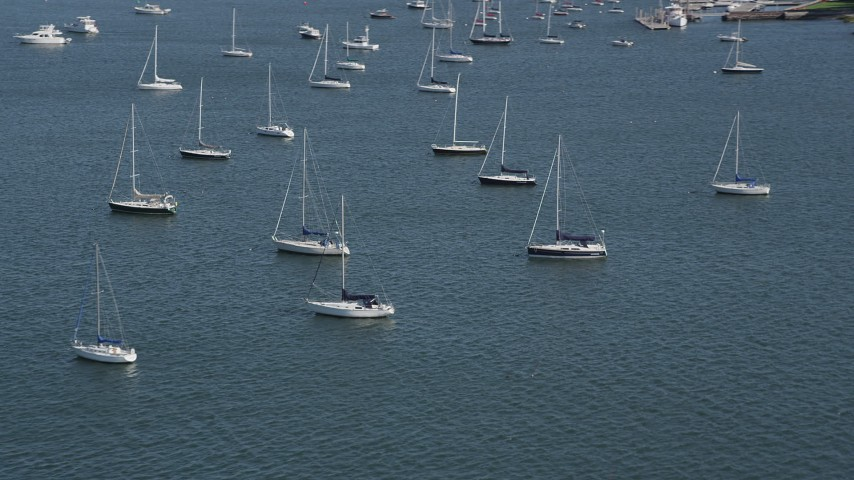 4K stock footage aerial video of passing by sailboats anchored in the water in Rye, New York Aerial Stock Footage | AX91_042