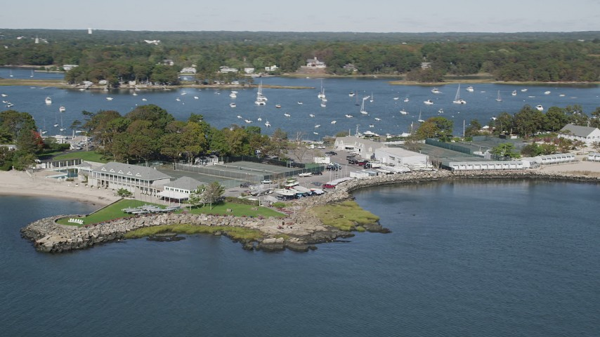 4K stock footage aerial video of passing the American Yacht Club, Rye, New York Aerial Stock Footage | AX91_044