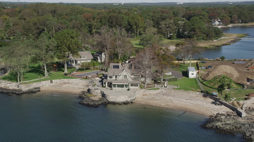 4K stock footage aerial video of flying by a spacious oceanside mansion, Rye, New York Aerial Stock Footage | AX91_045