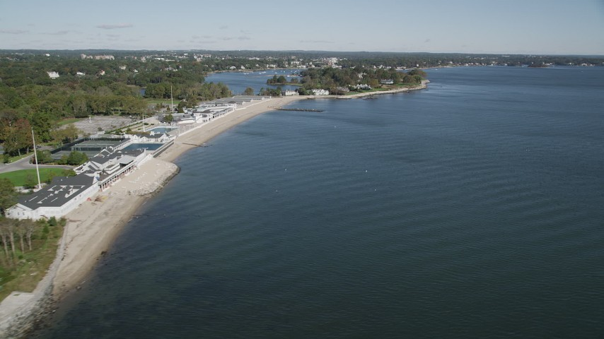 4K stock footage aerial video of flying by the beach and coastal neighborhoods in Rye, New York Aerial Stock Footage | AX91_053