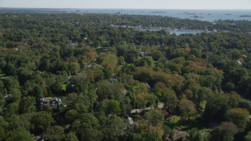 4K stock footage aerial video of flying over mansions and trees, Norwalk, Connecticut Aerial Stock Footage | AX91_088