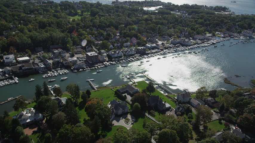 4K stock footage aerial video of flying by waterfront property on Five Mile River, Norwalk, Connecticut Aerial Stock Footage | AX91_091