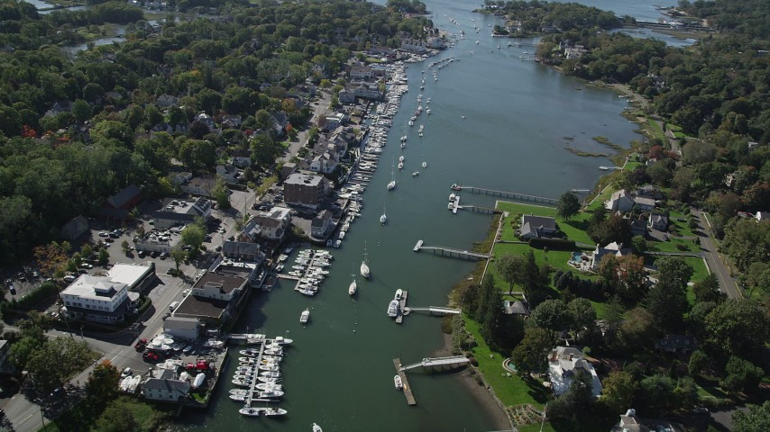 4K stock footage aerial video flyby waterfront property, boats and docks on Five Mile River, Norwalk, Connecticut Aerial Stock Footage | AX91_092
