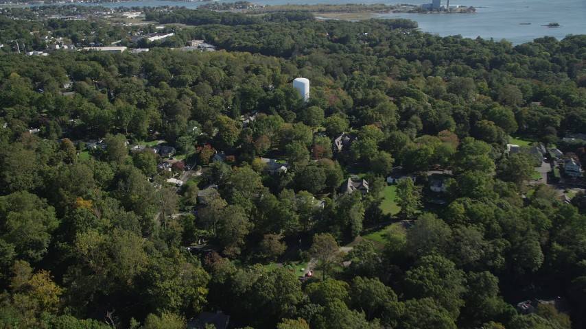 4K stock footage aerial video of flying over trees and suburban homes in Norwalk, Connecticut Aerial Stock Footage | AX91_093