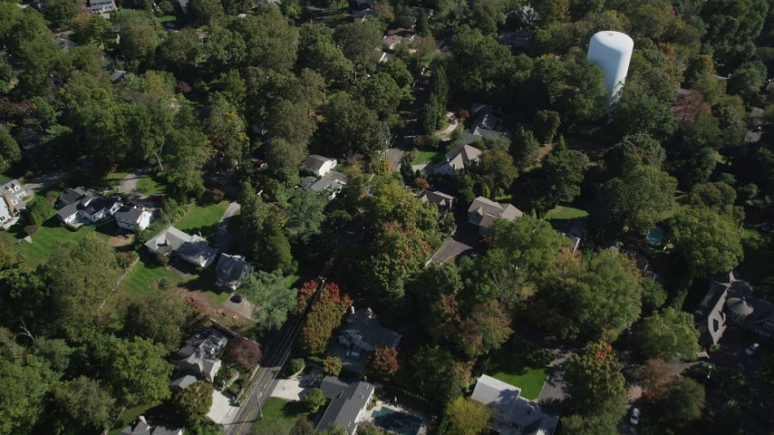 4K stock footage aerial video of tilting to suburban homes and neighborhoods with trees in Norwalk, Connecticut Aerial Stock Footage | AX91_094