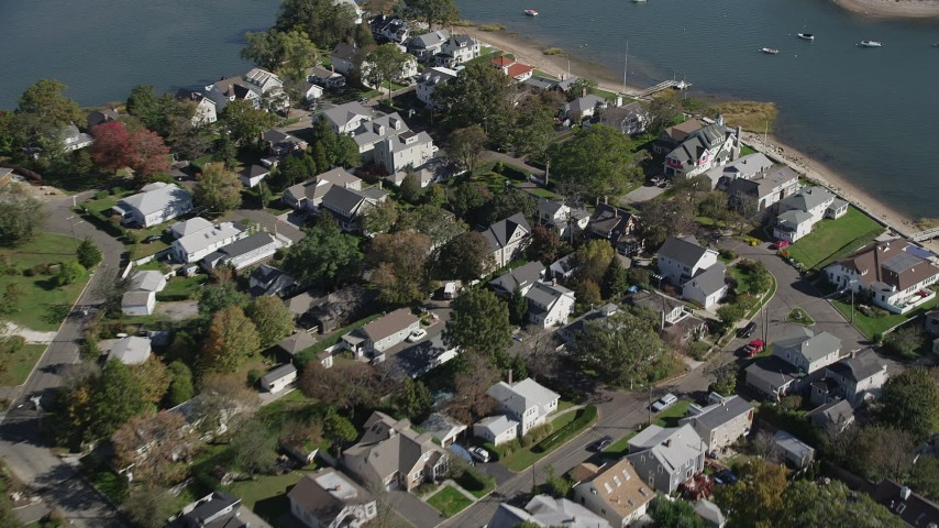 4K stock footage aerial video of flying over waterfront homes in Norwalk, Connecticut Aerial Stock Footage | AX91_097
