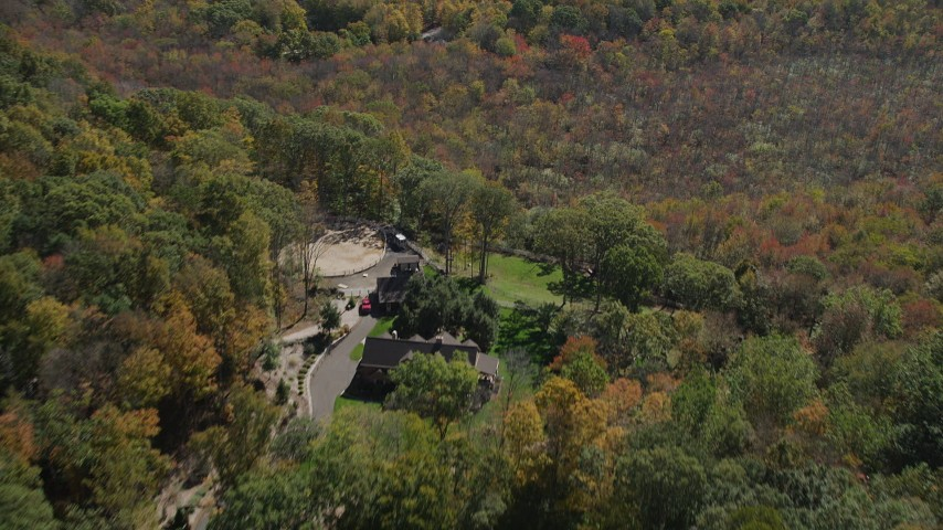 4K stock footage aerial video of flying over forest, revealing homes in autumn, Guilford, Connecticut Aerial Stock Footage | AX91_171