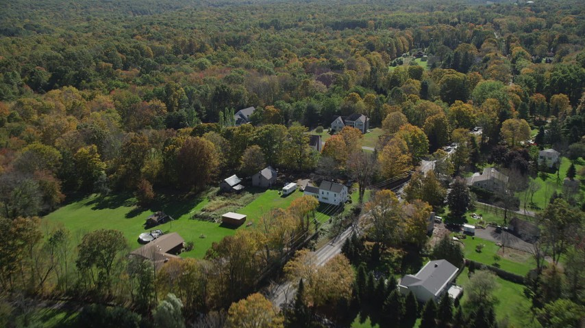 4K stock footage aerial video of flying over forest and suburban homes, autumn, Guilford, Connecticut Aerial Stock Footage | AX91_173