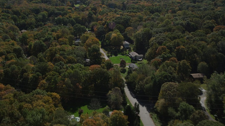4K stock footage aerial video of flying over forest, road and homes in autumn, Guilford, Connecticut Aerial Stock Footage | AX91_178