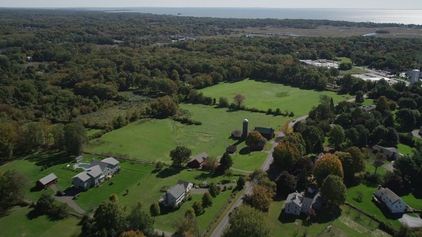 4K stock footage aerial video of flying over rural neighborhoods in autumn, Guilford, Connecticut Aerial Stock Footage | AX91_186