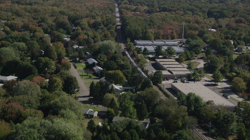 4K stock footage aerial video of tracking a passenger train through trees, autumn, Guilford, Connecticut Aerial Stock Footage | AX91_190