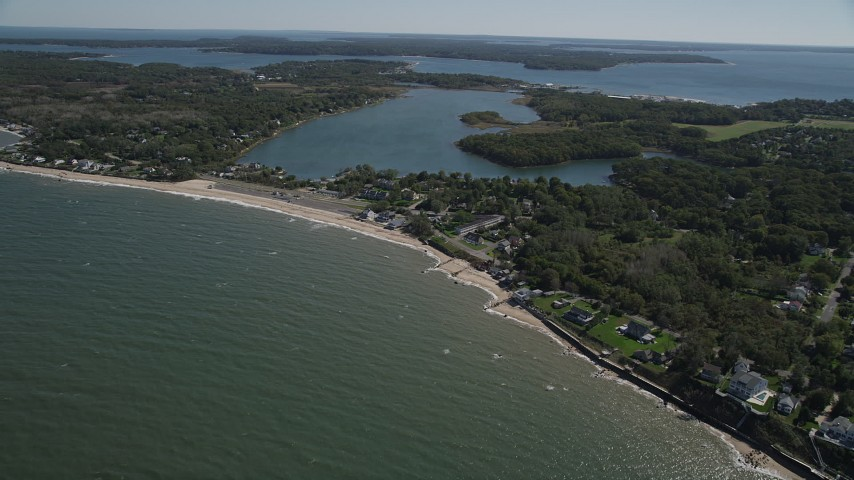 4K stock footage aerial video of approaching homes and beach near Hashamomuck Pond, Southold, New York Aerial Stock Footage | AX91_193