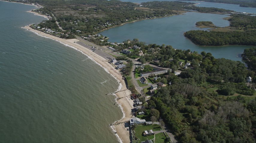 4K aerial stock footage video of flying by homes on the beach near Hashamomuck Pond, Southold, New York Aerial Stock Footage | AX91_194