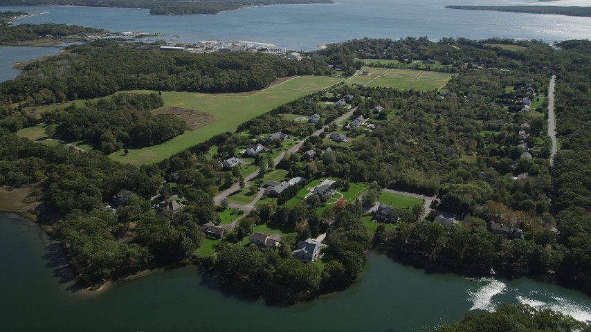 4K stock footage aerial video of approaching upscale, waterfront homes in Southold, New York Aerial Stock Footage | AX91_195