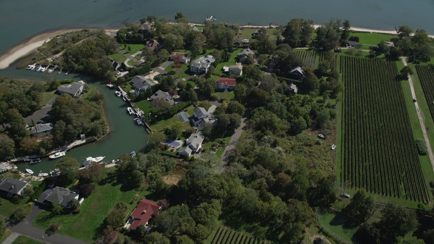 4K stock footage aerial video of flying by waterfront homes and a vineyard, Southold, New York Aerial Stock Footage | AX91_198