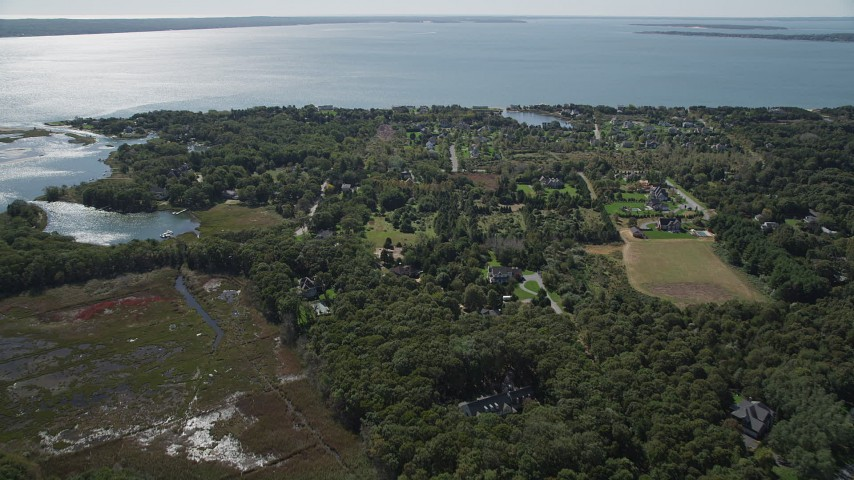 4K stock footage aerial video of approaching upscale homes on the coast in Southold, New York Aerial Stock Footage | AX91_201