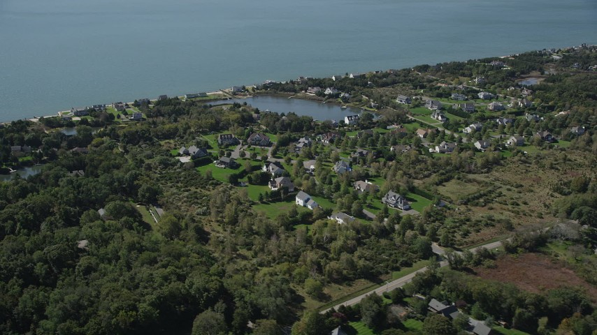 4K stock footage aerial video of flying by upscale homes in a coastal neighborhood, Southold, New York Aerial Stock Footage | AX91_202