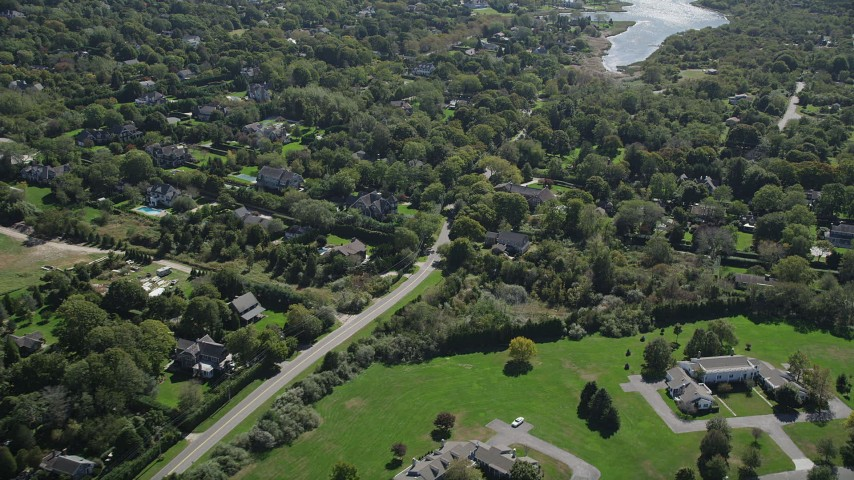 4K stock footage aerial video of flying by upscale homes in Southampton, New York Aerial Stock Footage | AX91_210