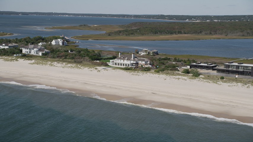 4K stock footage aerial video of flying by a beachfront mansion in Southampton, New York Aerial Stock Footage   AX91_218