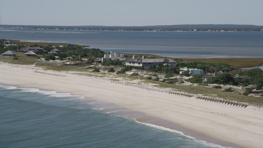 4K stock footage aerial video of flying by beachfront mansions, Southampton, New York Aerial Stock Footage | AX91_220