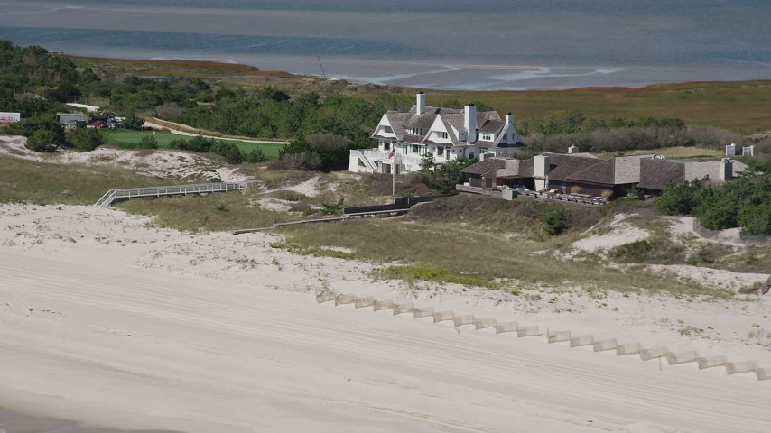 4K stock footage aerial video of upscale beach homes in Southampton, New York Aerial Stock Footage | AX91_221