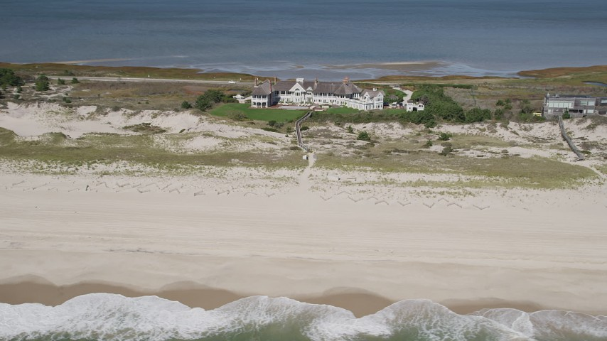 4K stock footage aerial video of flying by a beachfront mansion, Southampton, New York Aerial Stock Footage   AX91_226