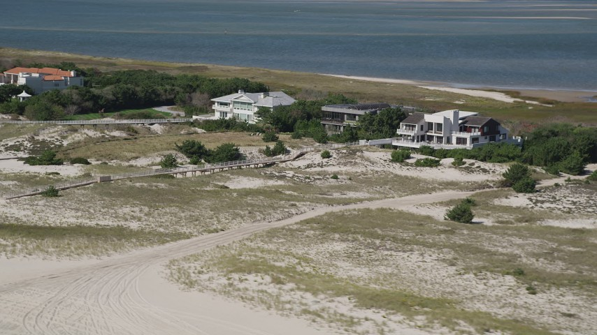 4K stock footage aerial video of flying by three beachside mansions, Southampton, New York Aerial Stock Footage | AX91_228