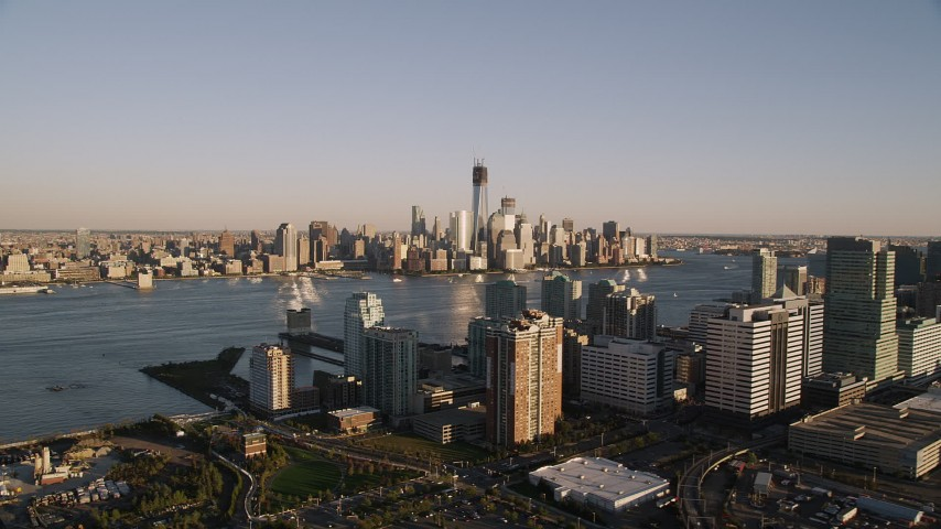 4K stock footage aerial video Approaching Lower Manhattan, seen from Jersey City, New York, New York, sunset Aerial Stock Footage | AX93_001