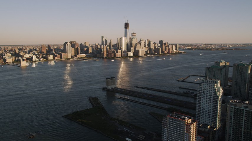 4K stock footage aerial video of Lower Manhattan, across the Hudson River, New York, New York, sunset Aerial Stock Footage | AX93_002