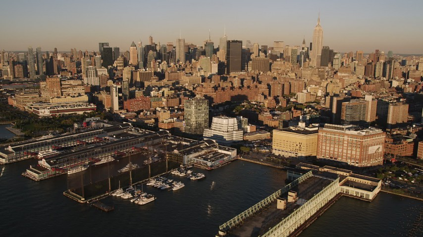 4K stock footage aerial video of Midtown Manhattan, from Chelsea Piers, New York, New York, sunset Aerial Stock Footage | AX93_005