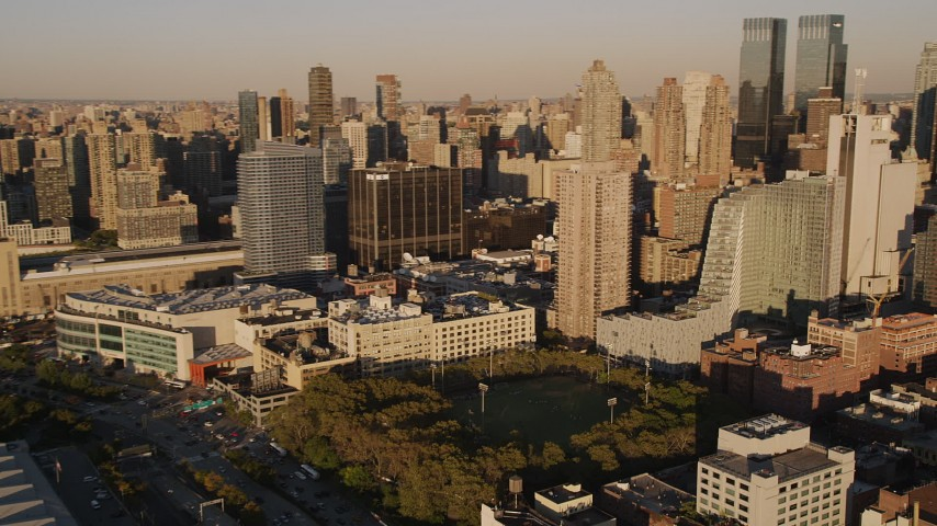 5k aerial video Flying by Midtown Manhattan skyscrapers, pan right, New York, New York, sunset Aerial Stock Footage | AX93_009