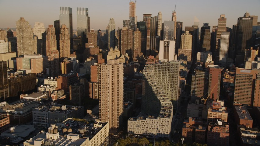 4K aerial video Flying by Midtown Manhattan skyscrapers, New York, New York, sunset Aerial Stock Footage | AX93_010