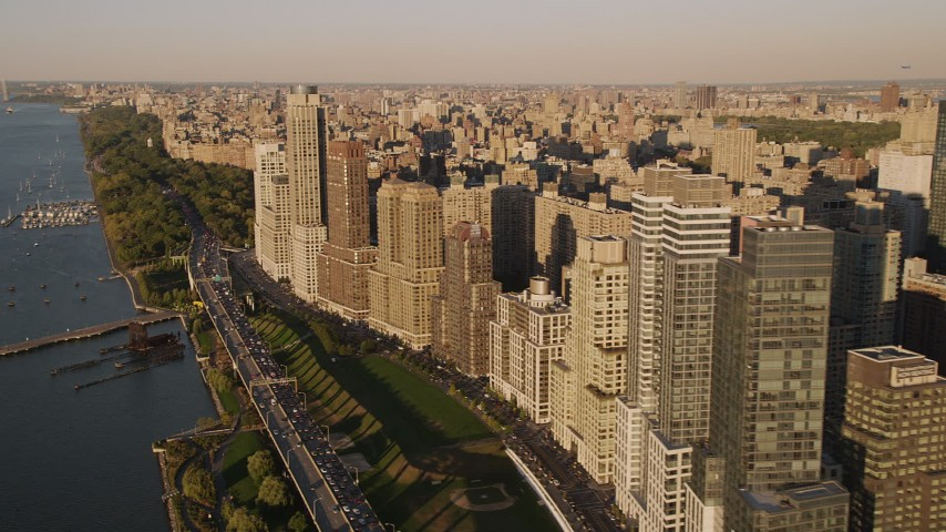 4K stock footage aerial video Flying by Henry Hudson Parkway, Upper West Side, New York, New York, sunset Aerial Stock Footage | AX93_011