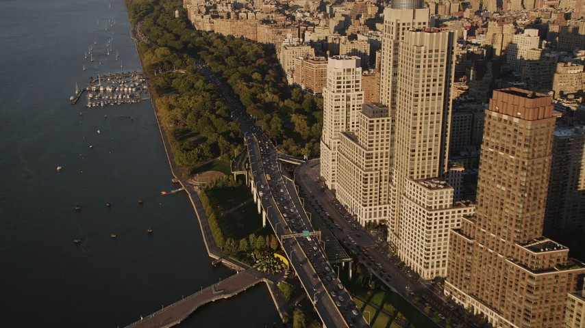 4K stock footage aerial video of Henry Hudson Parkway, Upper West Side, Riverside Park, New York, sunset Aerial Stock Footage | AX93_012