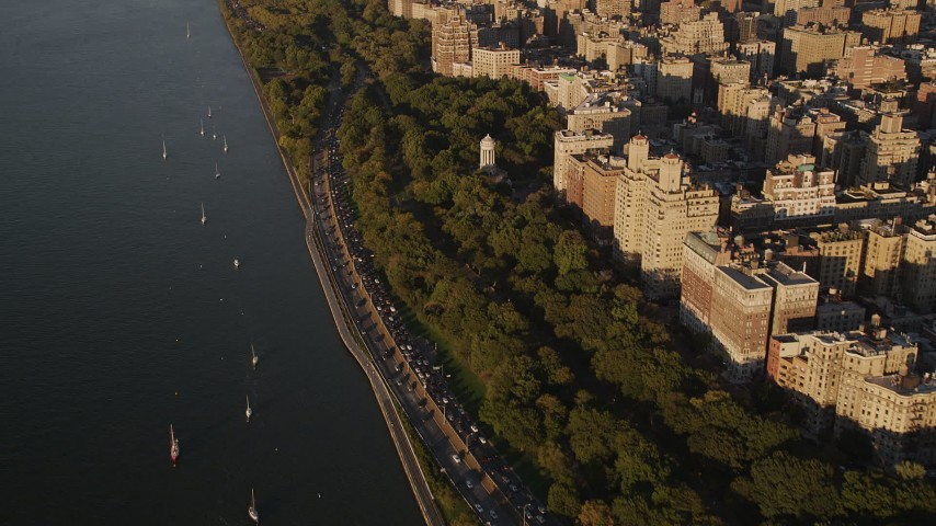 4K stock footage aerial video Flying by Henry Hudson Parkway, Upper West Side, New York, New York, sunset Aerial Stock Footage | AX93_014