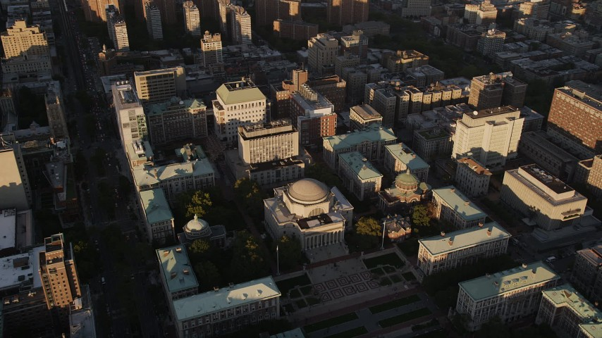 4K stock footage aerial video Flying by Columbia University, Morningside Heights, New York, New York, sunset Aerial Stock Footage | AX93_018