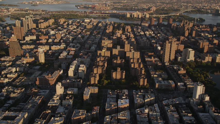 4K stock footage aerial video Approaching public housing, tilt down, Harlem, New York, New York, sunset Aerial Stock Footage | AX93_019