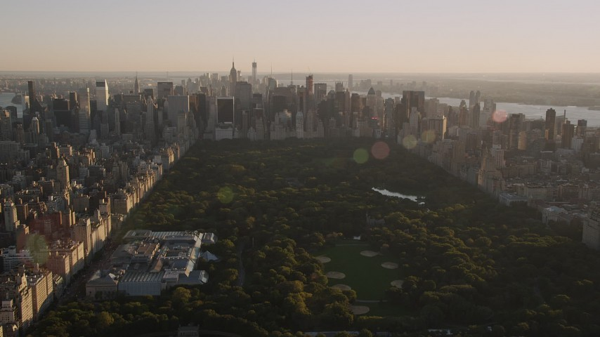 4K aerial video Approaching Midtown Manhattan, from Central Park, New York, New York, sunset Aerial Stock Footage | AX93_022
