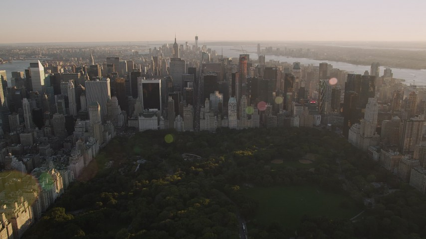 4K stock footage aerial video Approaching Midtown Manhattan, from Central Park, New York, New York, sunset Aerial Stock Footage | AX93_025