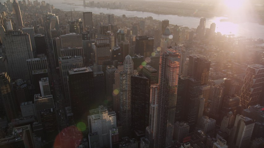 4K stock footage aerial video Flying by Midtown Manhattan, tilt down, New York, New York, sunset Aerial Stock Footage | AX93_028