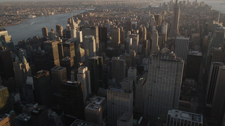 4K stock footage aerial video Flying by Midtown Manhattan skyscrapers, tilt down, New York, New York, sunset Aerial Stock Footage | AX93_029