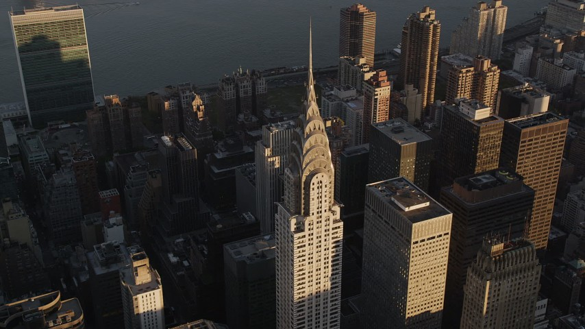 4K stock footage aerial video Flying by the Chrysler Building, Midtown Manhattan, New York, New York, sunset Aerial Stock Footage | AX93_032