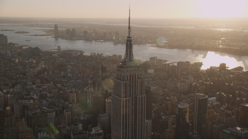 4K stock footage aerial video Flying by the Empire State Building, Midtown Manhattan, New York, sunset Aerial Stock Footage | AX93_033