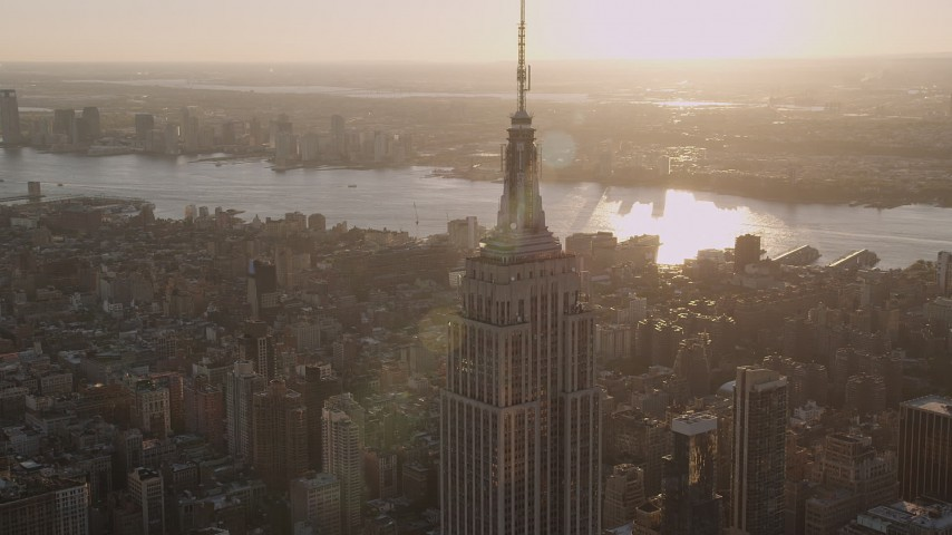 4K stock footage aerial video Flying by the Empire State Building, Midtown Manhattan, New York, sunset Aerial Stock Footage | AX93_034