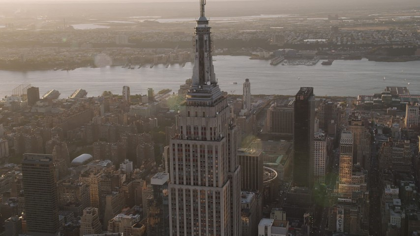 4K stock footage aerial video Flying by Empire State Building, Midtown Manhattan, New York, sunset Aerial Stock Footage | AX93_036