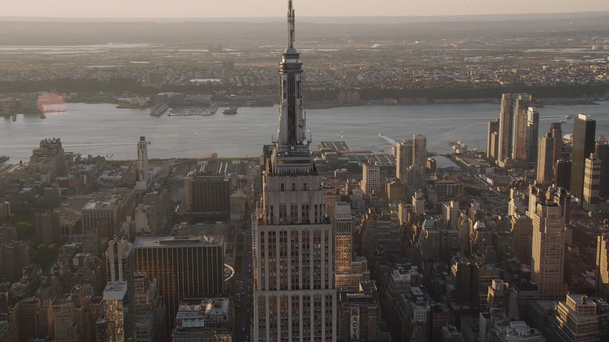 4K stock footage aerial video Flying by the Empire State Building, Midtown Manhattan, New York, sunset Aerial Stock Footage | AX93_037