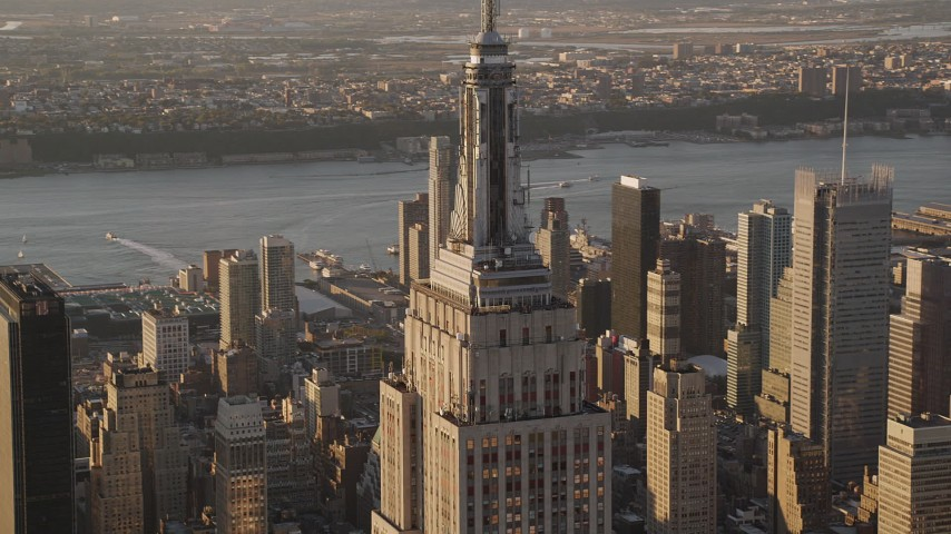 4K aerial video Flying by top of Empire State Building, Midtown Manhattan, New York, sunset Aerial Stock Footage | AX93_038