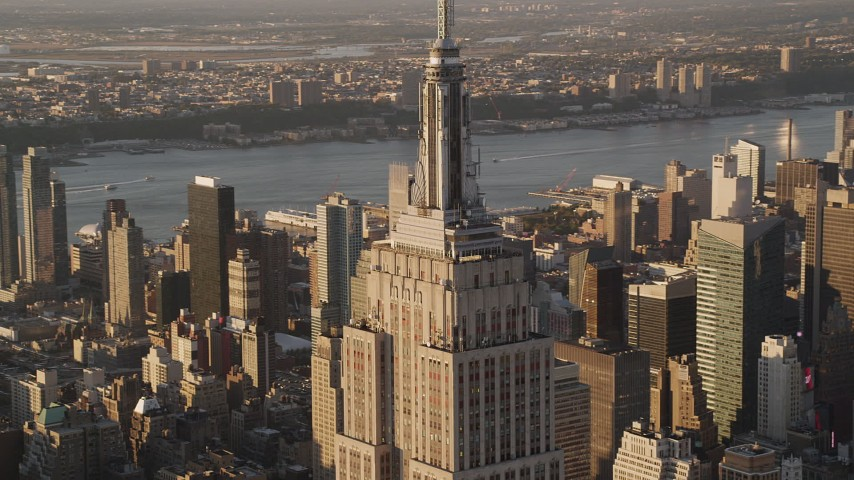 4K stock footage aerial video Flying by Empire State Building, Midtown Manhattan, New York, sunset Aerial Stock Footage | AX93_039