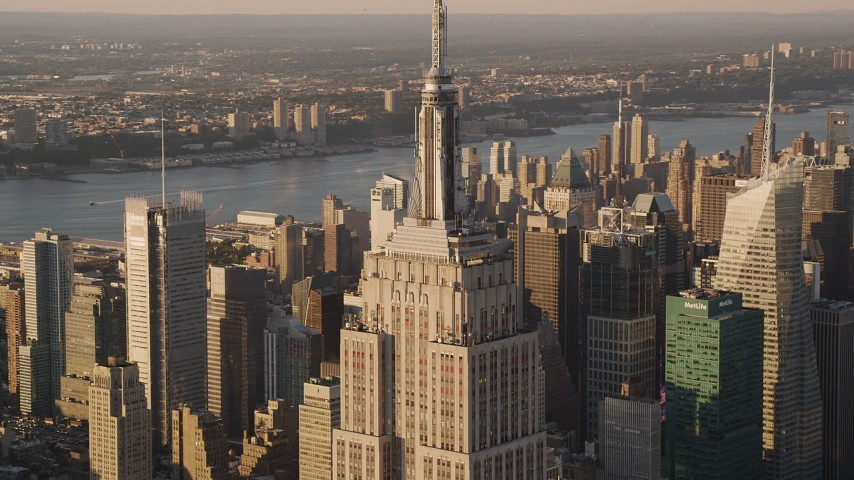 4K stock footage aerial video Flying by the Empire State Building, Midtown Manhattan, New York, sunset Aerial Stock Footage | AX93_040