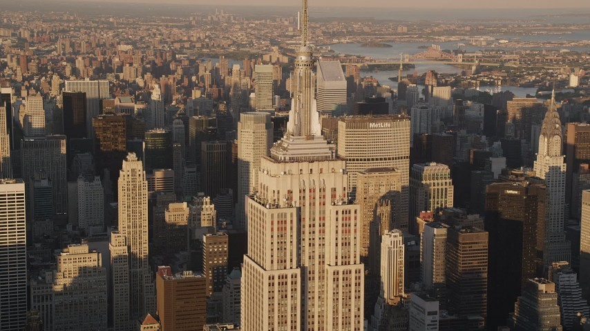 4K aerial video Flying by the Empire State Building, Midtown Manhattan, New York, sunset Aerial Stock Footage | AX93_043